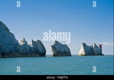 The Needles is a row of three distinct stacks of chalk that rise out of the sea off the western extremity of the - Stock Photo