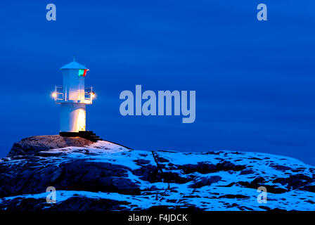 Bohuslan color image dusk evening horizontal lighthouse Marstrand navigate no people outdoors Scandinavia snow Sweden - Stock Photo