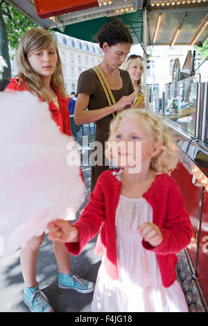 Family purchasing candy floss - Stock Photo