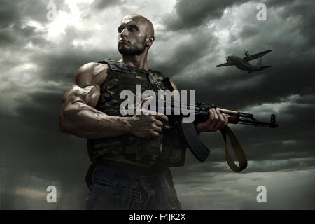 the soldier on a background of storm dramatic clouds - Stock Photo