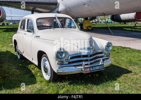 The festival 'Old Car Fest 2015', showed an old soviet 1955 Pobeda M-20 vintage model - Stock Photo