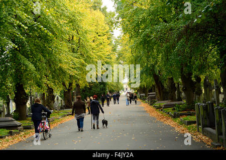 People stroll through Brompton Cemetery in London. - Stock Photo