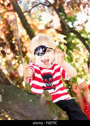 Portrait of boy wearing pirate costume - Stock Photo