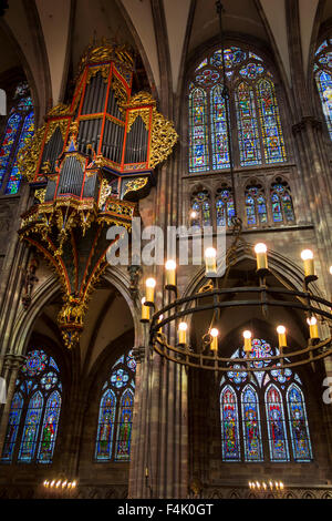 Pipe organ and stained glass windows in the Cathedral of Our Lady of Strasbourg / Cathédrale Notre-Dame de Strasbourg, - Stock Photo