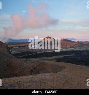 Dawn moon over the smouldering lava field at Leirhnjukur, Krafla volcano, Myvatn, Nordhurland Eystra, Iceland. - Stock Photo