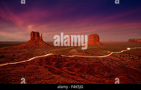 Car lights trails in Monument Valley at night, USA. - Stock Photo