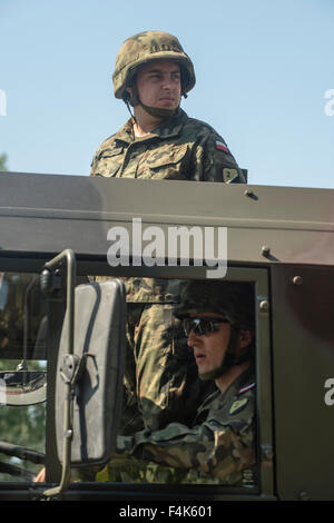 Two soldiers of the Polish Military attends the National Army Day in Warsaw - Stock Photo
