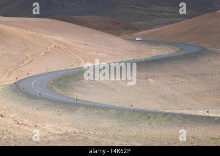 Switchbacks as the Ring Road descends volcanic hills, Hverir, Myvatn, Nordhurland Eystra, Iceland. - Stock Photo