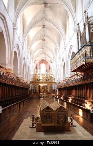 Central nave from Las Huelgas Church, with high medieval arcs, organ, and king's tomb in the center - Stock Photo