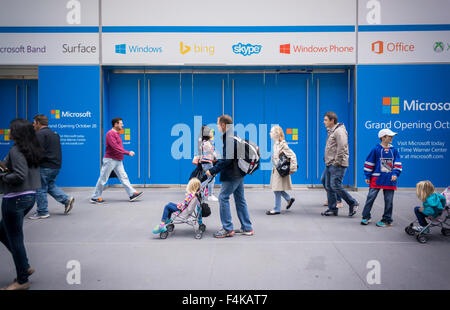 Passer-by walk past the soon to be opened flagship Microsoft store on Fifth Avenue, seen on Friday, October 16, - Stock Photo