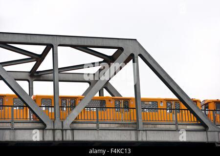 Yellow Metro over the bridge, Berlin, Germany. Isolated on white. - Stock Photo