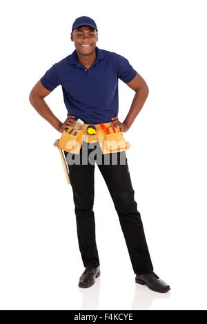 smiling African American handyman standing on white background - Stock Photo