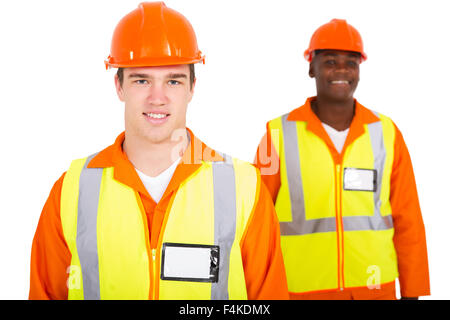 handsome young Caucasian engineer with co-worker - Stock Photo