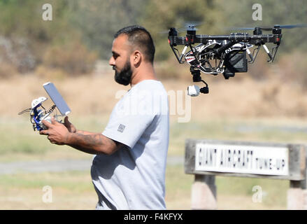 Van Nuys. 19th Oct, 2015. CA/US. Drone flyer Robert Canas flies his drone at the Woodley airpark Monday.Today in - Stock Photo