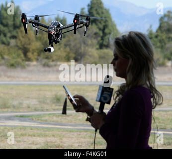 Van Nuys. 19th Oct, 2015. CA/US. Local TV news crews shoot and talk with local drone flyers at Woodley Airpark Monday.Today - Stock Photo