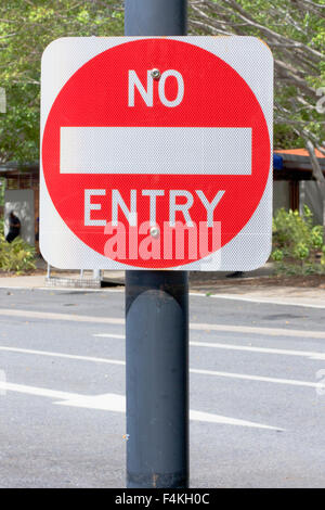 No Entry Sign on the side of the road - Stock Photo