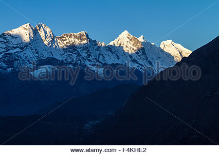 Stark Himalaya Mountains float majestically above the landscape - Stock Photo