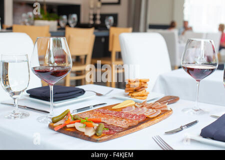 Wine and charcuterie board - Stock Photo