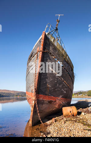 Old fishing boat washed up on the shores of Loch Linne, Fort William, Highland, Scotland, UK - Stock Photo