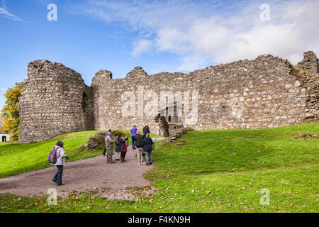 Tourists at Old Inverlochy Castle, Fort William, Highland, Scotland, UK - Stock Photo