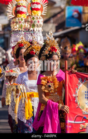 Balinese villagers participating in Sanur Village Festival's street parade - Stock Photo
