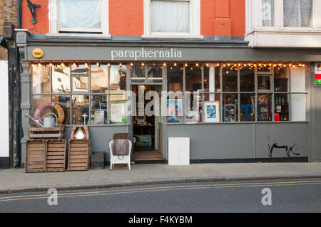Paraphernalia shop in Margate's old town, with graffiti of a pig by Stewy. - Stock Photo