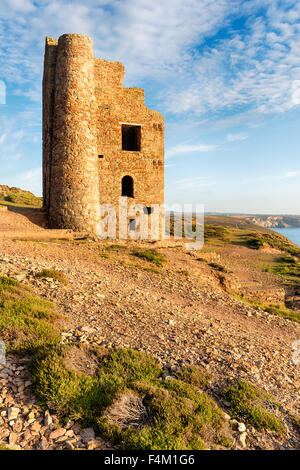 Mine ruins above Chapel Porth beach at St Agnes on the north coast of Cornwall - Stock Photo