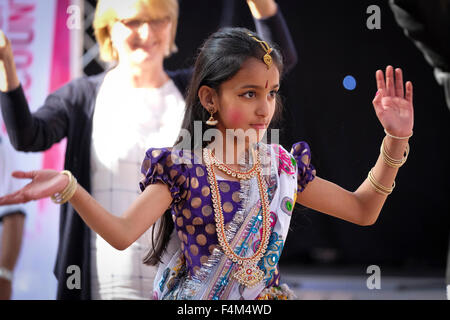 Young Indian girl in traditional Indian costume dancing - Stock Photo