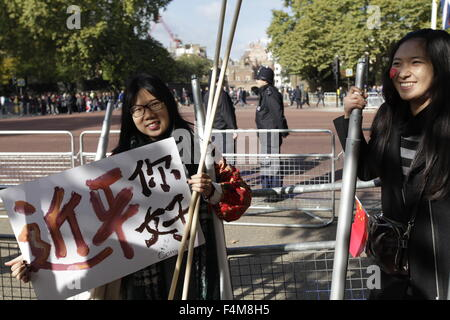 London, UK. 20th Oct, 2015. Young person raises a brouchure with Chinese words ' Hello, Jingping'   in London , - Stock Photo