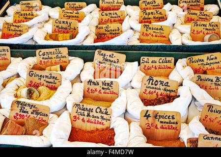 Street market stall display of spices in Objat, Correze, Limousin, France. - Stock Photo