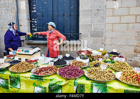 Street market stall selling olives in Objat, Correze, Limousin, France. - Stock Photo