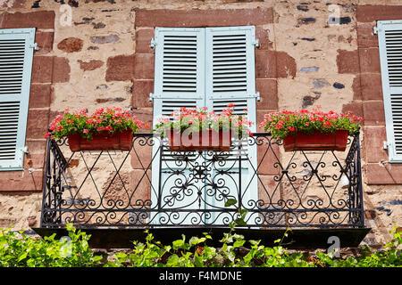 Decorative French balcony in Le Saillant, Correze, Limousin, France. - Stock Photo