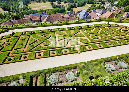 Elevated view of the formal gardens at  Chateau de Hautefort. Hautefort, Dordogne, Aquitaine, France. - Stock Photo