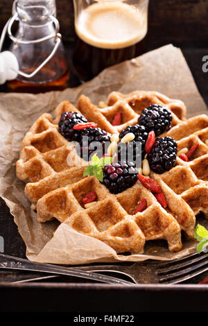Whole wheat breakfast waffle served with blackberries and goji berries - Stock Photo