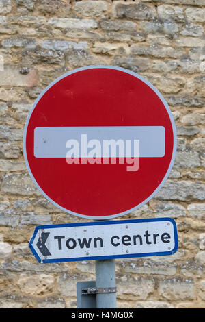 Pointing the way to the town centre via a no entry sign, England, UK - Stock Photo