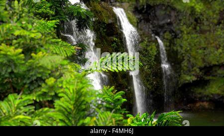 Upper Waikani Falls or Three Bears Falls along the road to Hana on the island of Maui - Stock Photo