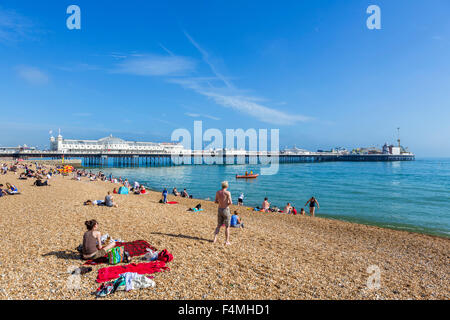 Brighton beach, Brighton, Sussex. The beach and pier in late afternoon sunshine, Brighton, East Sussex, England, - Stock Photo