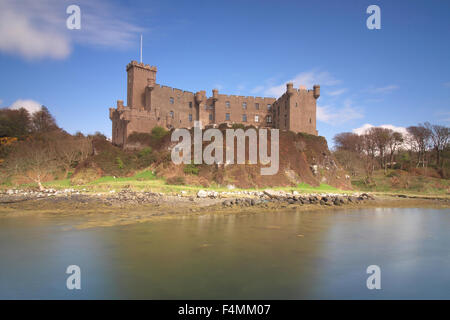 Dunvegan Castle by Loch Dunvegan on a sunny day - Stock Photo