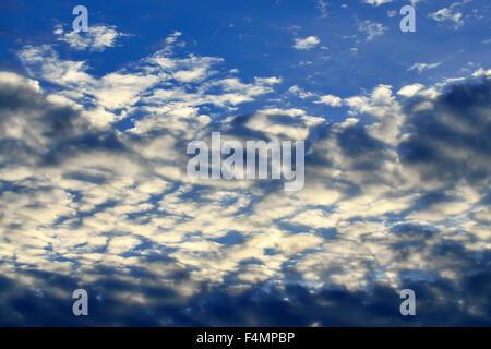 White Cumulus clouds against blue sky closeup - Stock Photo