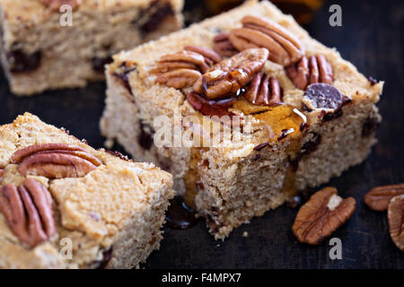 Pecan and dark chocolate blondies bar cookies with syrup - Stock Photo