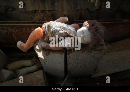 A doll left behind after the Chernobyl disaster 1986 in the kindergarten Zolotoj Kluchik. Pripyat, Zone of Alienation, - Stock Photo