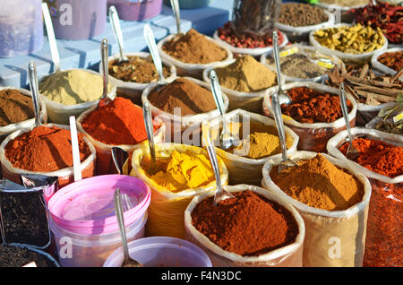 Spices on display in an Indian market - Stock Photo