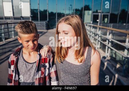 Two teenagers on pedestrian bridge - Stock Photo
