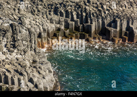 Jungmun Daepo Haean Jusangjeollidae at Jeju Island - The largest pillar rock formation in  South Korea - Stock Photo