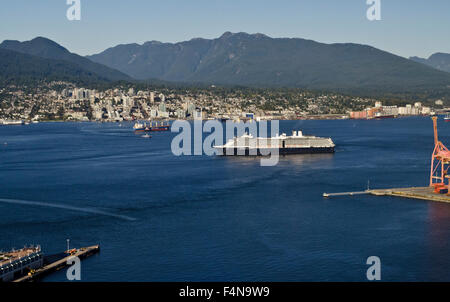 Cruise ship in the Vancouver waters of the Burrard Inlet.  North shore mountains and city. - Stock Photo
