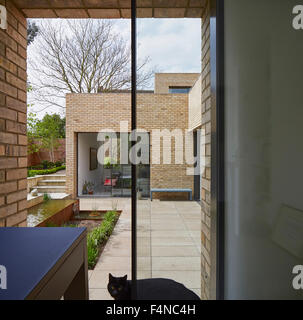 Office window with courtyard view. Luker House, London, United Kingdom. Architect: Jamie Fobert Architects, 2014. - Stock Photo