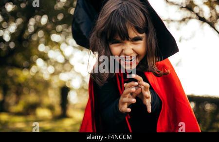 Portrait of little girl masquerade as vampire - Stock Photo