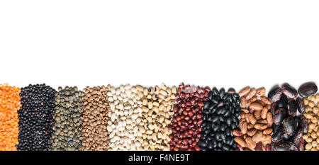 various dried legumes on white background - Stock Photo