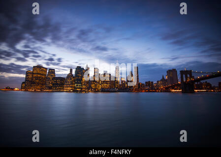 Blue hour shot of the Lower Manhattan skyline, taken from Brooklyn in New York USA - Stock Photo