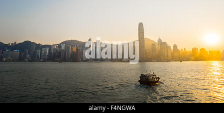 Victoria Harbour, Hong Kong Convention and Exhibition Center in twilights - Stock Photo
